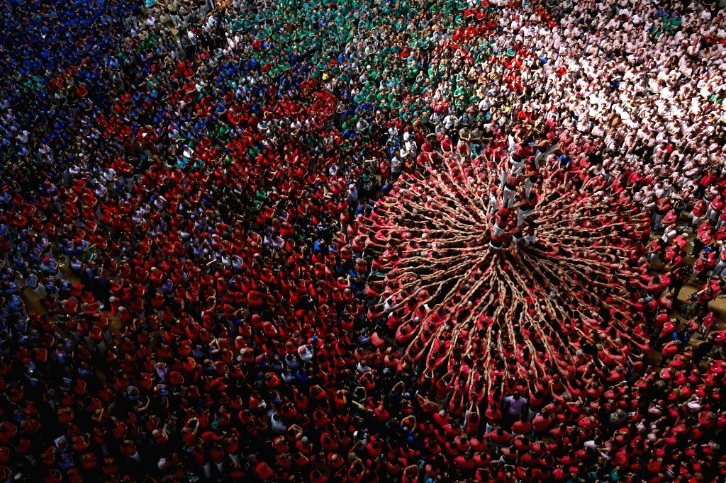 TARRAGONA (SPAIN), Oct. 3, 2016 Members of a human tower group perform during the 26th Human Towers Competition in the old bullring of Tarragona, Spain, Oct. 2, 2016.