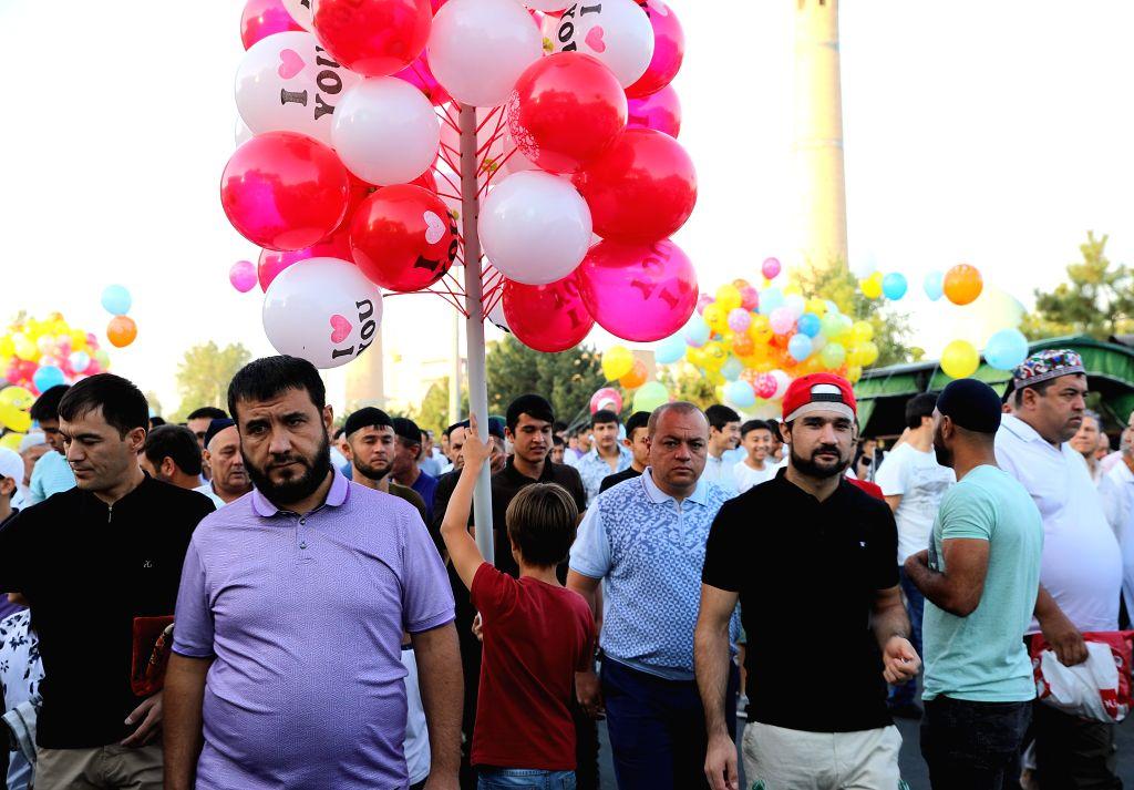 TASHKENT, Aug. 11, 2019 - People attend the Eid al-Adha festival in Tashkent, Uzbekistan, Aug. 11, 2019.