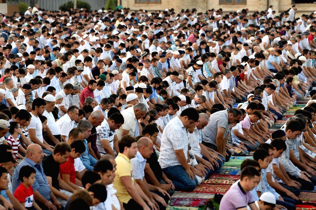 TASHKENT, Aug. 11, 2019 - People offer prayers during Eid al-Adha festival in Tashkent, Uzbekistan, Aug. 11, 2019.