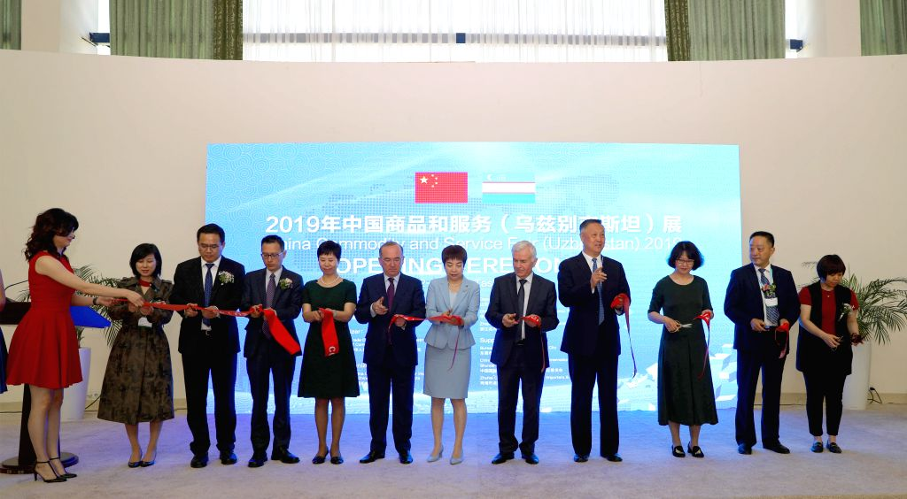 TASHKENT, June 13, 2019 - Guests cut the ribbon during the opening ceremony of China Commodity and Service Fair in Tashkent, Uzbekistan, June 12, 2019. Construction and agricultural equipment, auto ...