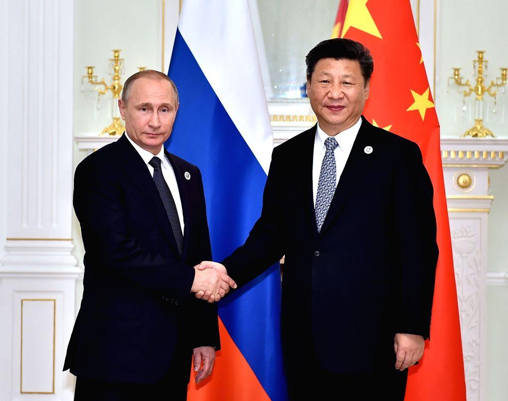 TASHKENT, June 23, 2016 - Chinese President Xi Jinping (R) meets with Russian President Vladimir Putin in Tashkent, Uzbekistan, June 23, 2016.
