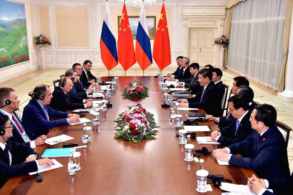TASHKENT, June 23, 2016 - Chinese President Xi Jinping meets with Russian President Vladimir Putin in Tashkent, Uzbekistan, June 23, 2016.
