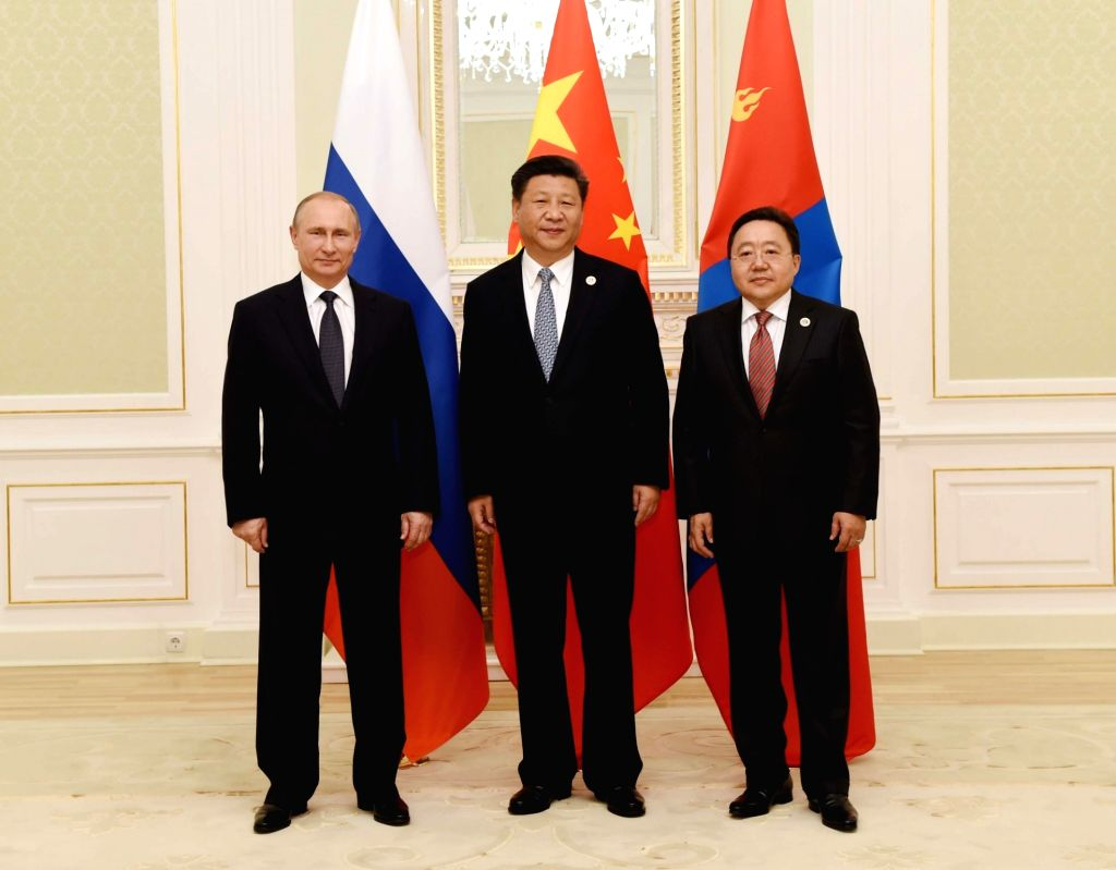 TASHKENT, June 23, 2016 - Chinese President Xi Jinping (C), Russian President Vladimir Putin (L) and Mongolian President Tsakhiagiin Elbegdorj (R) attend the third trilateral leaders' meeting of the ...