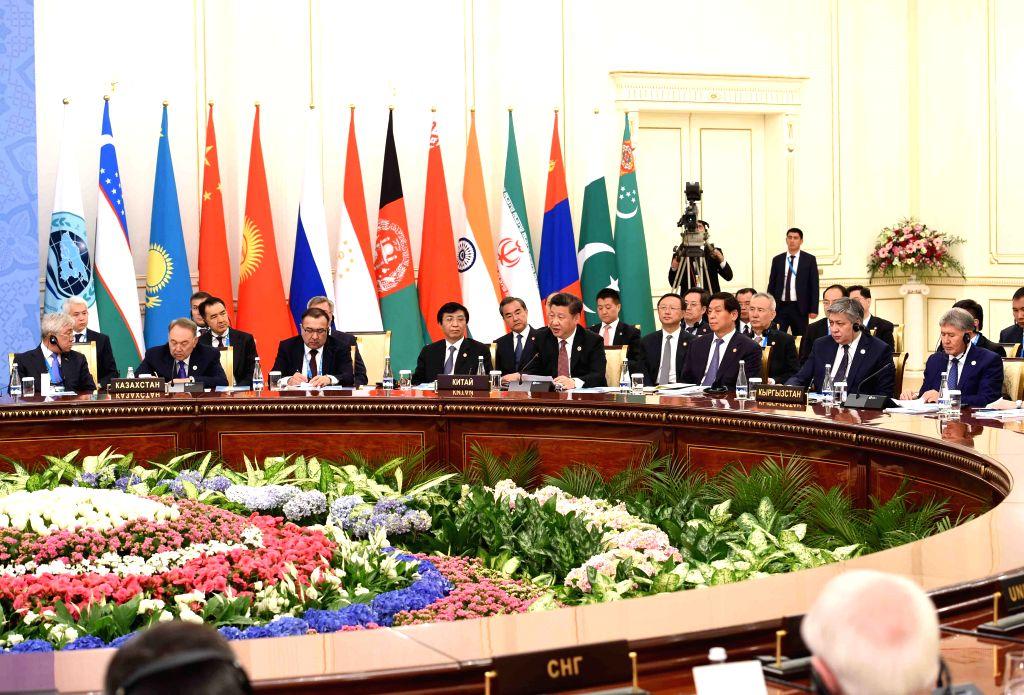 TASHKENT, June 24, 2016 - Chinese President Xi Jinping attends the 16th Shanghai Cooperation Organization (SCO) Council of Heads of State meeting in Tashkent, Uzbekistan, June 24, 2016.