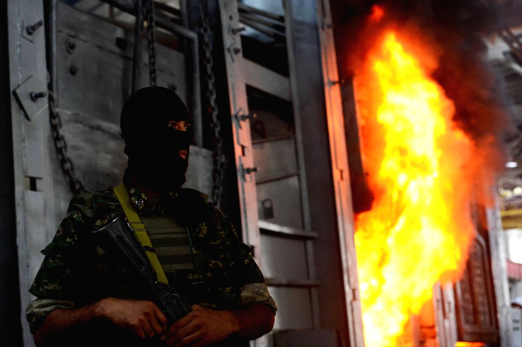 TASHKENT, June 24, 2017 - A member of the narcotics squad stands guard as the confiscated drugs were burned at a factory in suburban Tashkent, Uzbekistan, June 23, 2017. Uzbekistan National Security ...