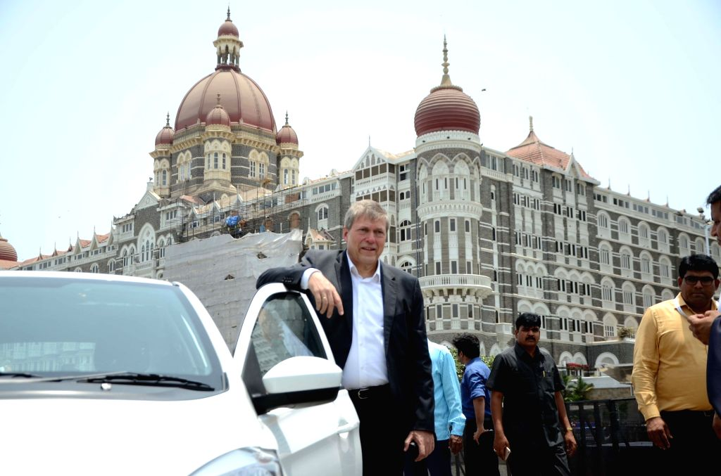 Tata Motors CEO & MD Guenter Butschek at the flagging off ceremony of Electric Vehicles at the launch of a service where all-electric city car will be available on rent for residents and ...