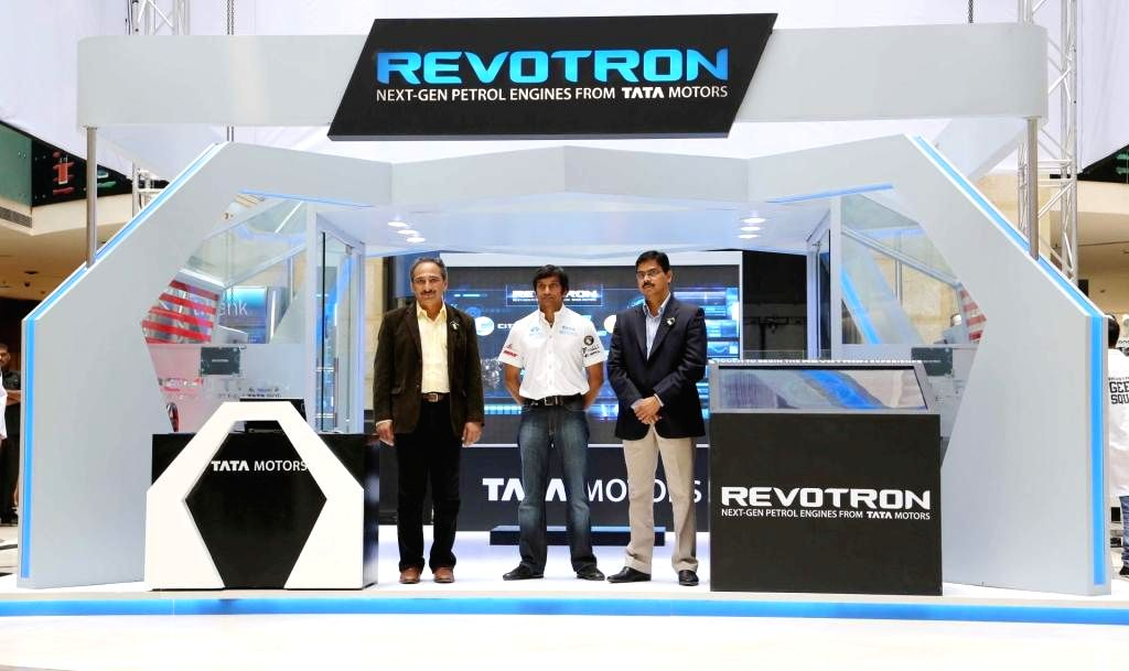 Tata Motors Passenger Vehicles Business President Ranjit Yadav, India's first F1 driver Narain Karthikeyan and Tata Motors Programme Planning and Project Management Senior Vice President Girish Wagh . - Narain Karthikeyan and Ranjit Yadav