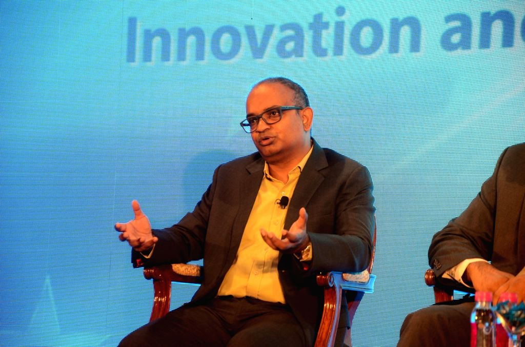 """Tata Sons Group Chief Technology Officer Dr Gopichand Katragadda addresses during """"Reimagine & Reinvent - Innovation and Technology"""" a programme in Mumbai on May 11, 2017."""