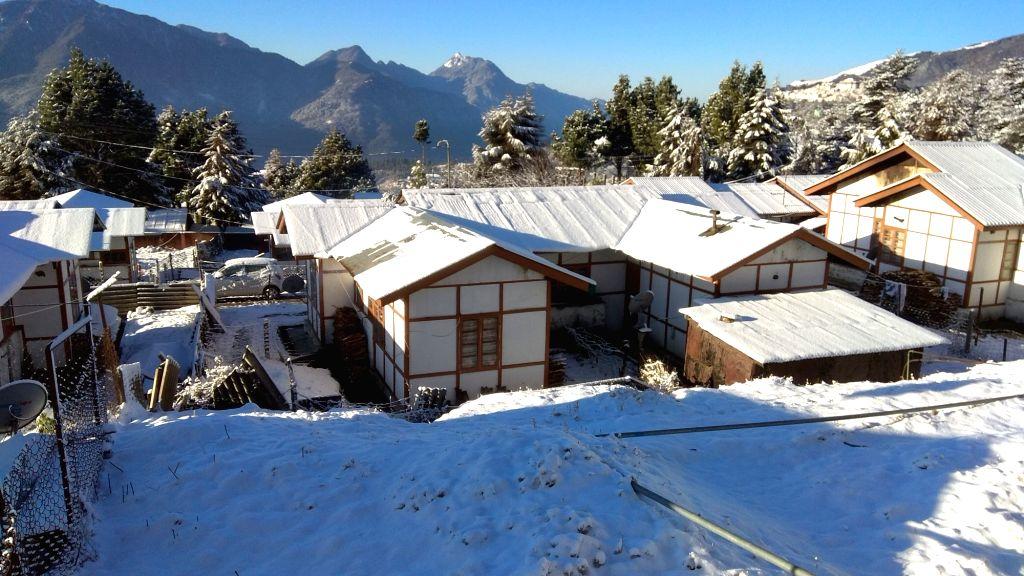 Tawang (Arunachal): A view of snow clad rooftops of houses in Tawang of Arunachal Pradesh on Feb 15, 2018.