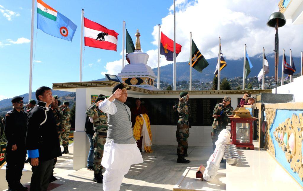 Tawang: Defence Minister Rajnath Singh and Arunachal Pradesh Chief Minister Pema Khandu offer tributes to the fallen soldiers who made their supreme sacrifice during the War of 1962, at Tawang War Memorial in Arunachal Pradesh's Tawang on Nov 14, 201 - Rajnath Singh