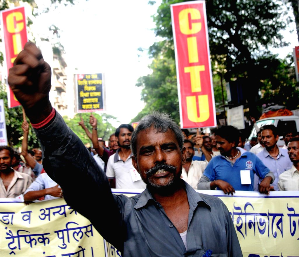 Taxi drivers stage a demonstration police atrocities in Kolkata on Aug 28, 2014.