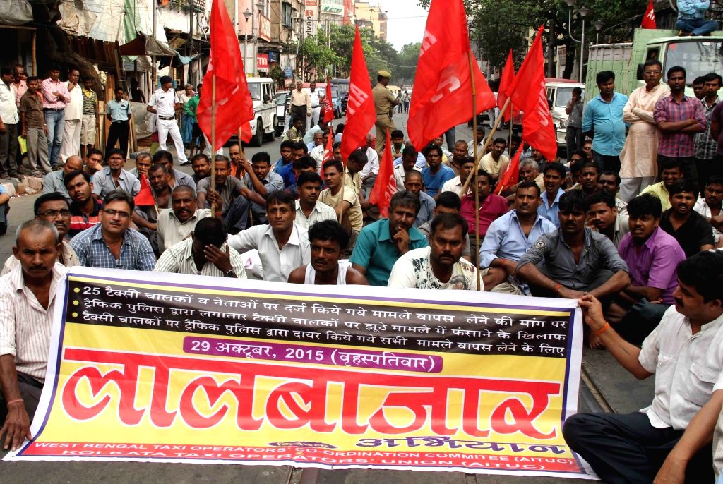 Taxi drivers stage a demonstration to press for their demands in Kolkata, on Oct 29, 2015.