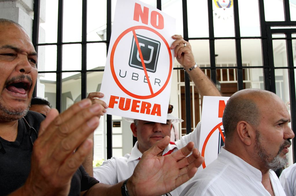 Taxi drivers take part in a protest against the transport sevice through apps like Uber, in front of Colombia's embassy to Costa Rica, in San Jose, capital of ...