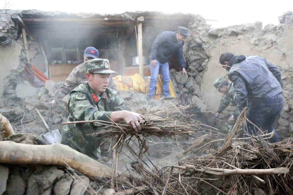 TAXKORGAN, May 11, 2017 - Rescuers work at Kuzigun Village in Taxkorgan County, northwest China's Xinjiang Uygur Autonomous Region, May 11, 2017. Eight people have been confirmed dead and 11 others ...