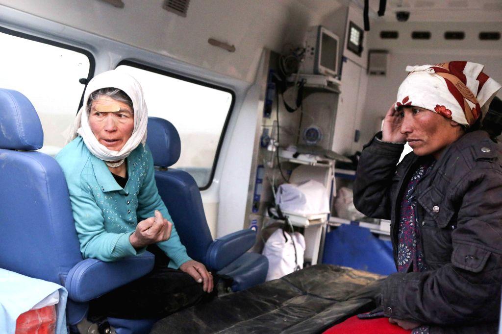 TAXKORGAN, May 11, 2017 - Residents receive treatment at Kuzigun Village in Taxkorgan County, northwest China's Xinjiang Uygur Autonomous Region, May 11, 2017. Eight people have been confirmed dead ...