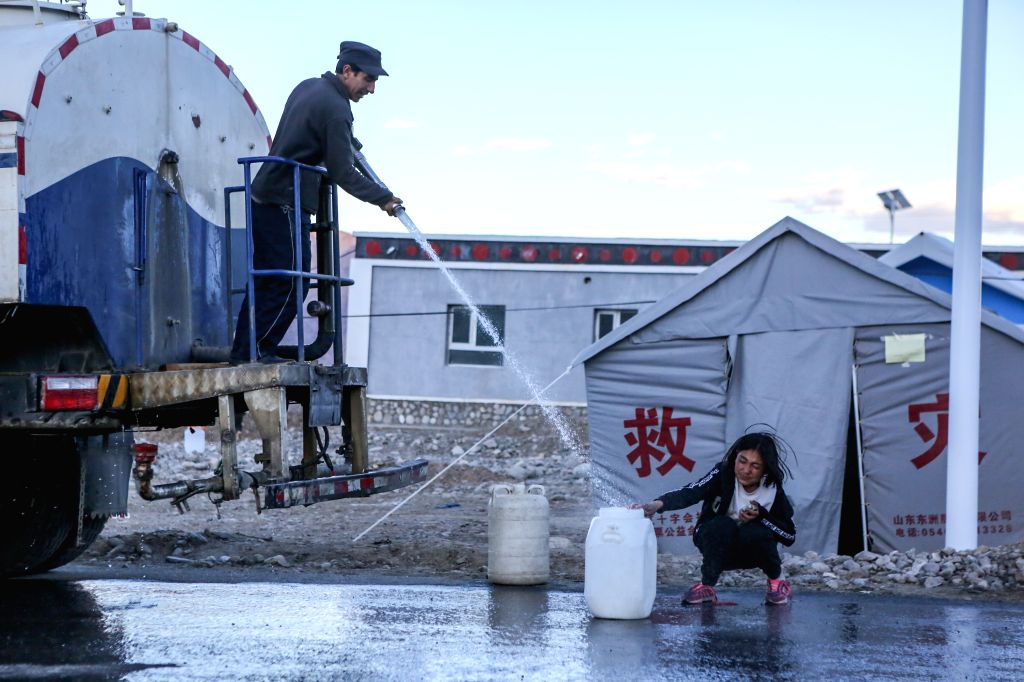 TAXKORGAN, May 12, 2017 - A villager gets water at an emergency shelter in Quzgun Village of quake-hit Taxkorgan County, northwest China's Xinjiang Uygur Autonomous Region, May 12, 2017. Eight people ...