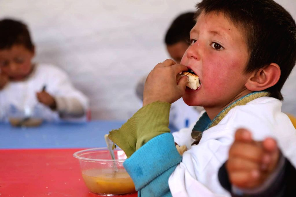 TAXKORGAN, May 13, 2017 - A little boy has lunch at a temporary kindergarten of an emergency shelter in Quzgun Village of quake-hit Taxkorgan County, northwest China's Xinjiang Uygur Autonomous ...