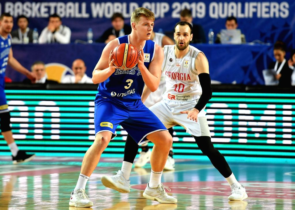 TBILISI, Feb. 25, 2019 - Georgia's Duda Sanadze (R) vies with Estonia's Kaspar Treier during the European qualifier of the FIBA Basketball World Cup 2019 between Georgia and Estonia in Tbilisi, ...
