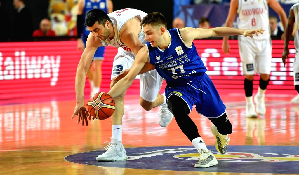 TBILISI, Feb. 25, 2019 - Georgia's Giorgi Shermadini(L) vies with Estonia's Kristian Kullamae during the European qualifier of the FIBA Basketball World Cup 2019 between Georgia and Estonia in ...