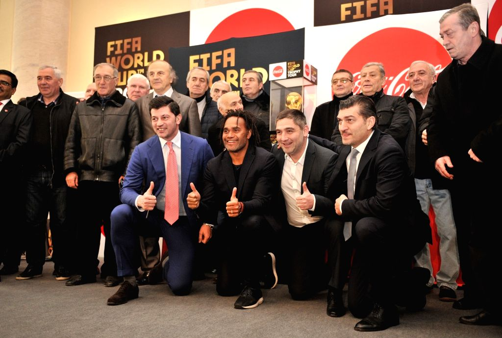 TBILISI, Feb. 8, 2018 - Former French player Christian Karembeu (2nd L, Front) and Georgian football star Kakha Kaladze (1st L, Front) gesture as they present the FIFA World Cup Trophy during a ...