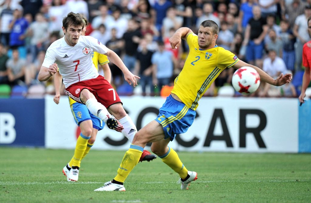 TBILISI, July 6, 2017 - Georgia's Giorgi Kokhreidze (L) vies with Sweden's Mattias Andersson during the Group A match of the European U19 Championship between Georgia and Sweden in Tbilisi, Georgia, ...