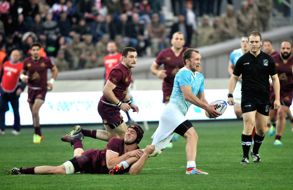 TBILISI, March. 13, 2017 - Georgia's B. Gorgadze (bottom) vies with Russia's K. Uzunov (2nd R) during the match of Rugby Europe Champioships 2017 between Georgia and Russia in Tbilisi, Georgia, March ...