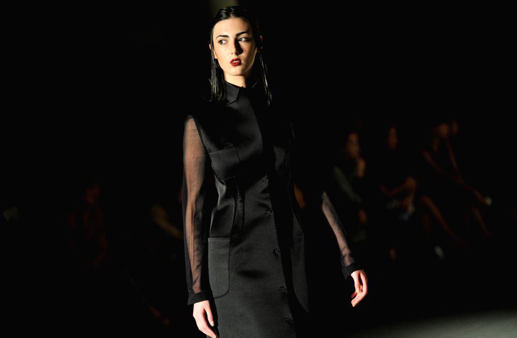 A model presents a creation of David Sulikashvili during the Mercedes Benz Fashion Week, in Tbilisi, capital of Georgia, on May 1, 2015. (Xinhua/Giorgi ...