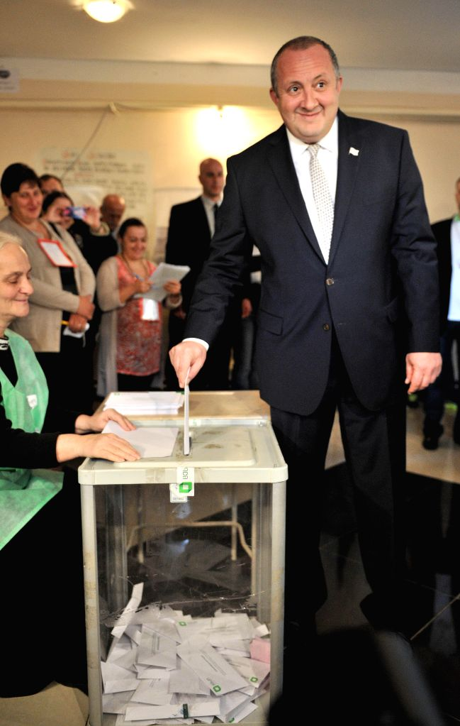TBILISI, Oct. 8, 2016 - Georgian President Giorgi Margvelashvili casts his vote at a polling station in Tbilisi, Georgia, on Oct. 8, 2016. Georgia kicked off the parliamentary election from 8:00, ...