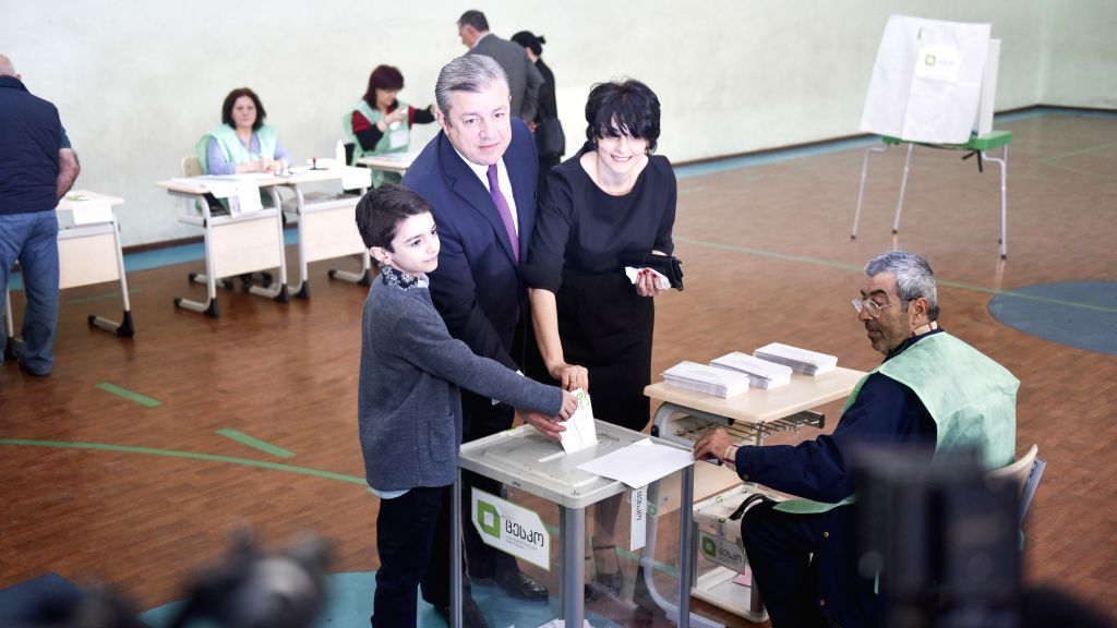 TBILISI, Oct. 8, 2016 - Georgian Prime Minister Giorgi Kvirikashvili (C) casts his vote with his wife and son at a polling station in Tbilisi, Georgia, on Oct. 8, 2016. Georgia kicked off the ... - Giorgi Kvirikashvili