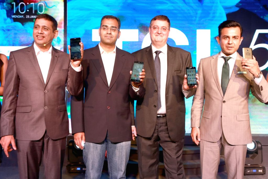 TCL Vice President Nicolas Zibell and others at the launch of TCL's first mobilephone - TCL 560 in New Delhi, on July 3, 2016.
