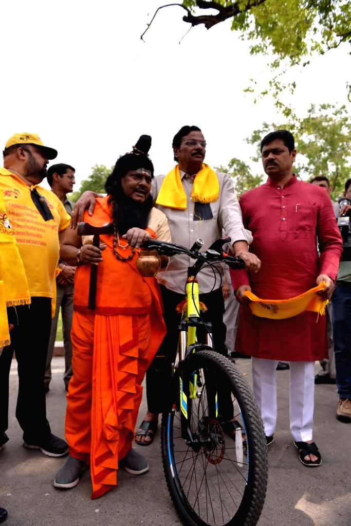 TDP legislator stage a demonstration at Parliament in New Delhi on April 6, 2018.