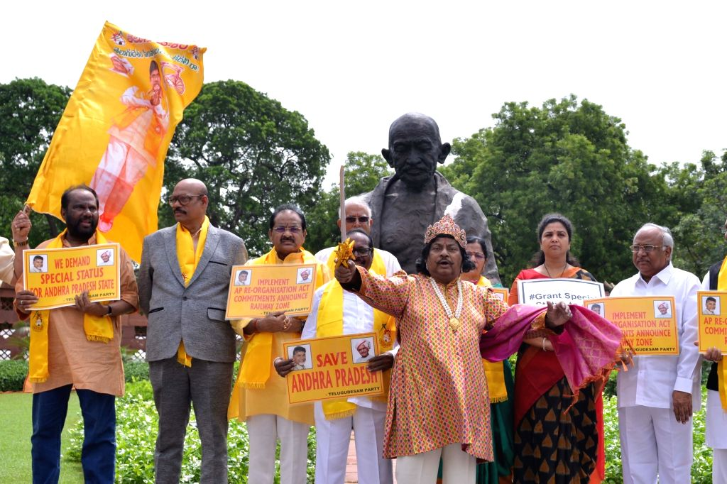 TDP legislators led by party MP Chittoor Naramalli Sivaprasad stage a demonstration demanding special category status for Andhra Pradesh; in front of Gandhi statue at Parliament in New ...