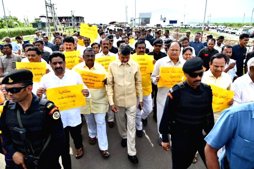 TDP legislators led by party President N. Chandrababu Naidu stage a walk out of the Andhra Pradesh Assembly alleging that the Speaker K. Siva Prasad Rao did not give them a chance to ... - K. Siva Prasad Rao and N. Chandrababu Naidu
