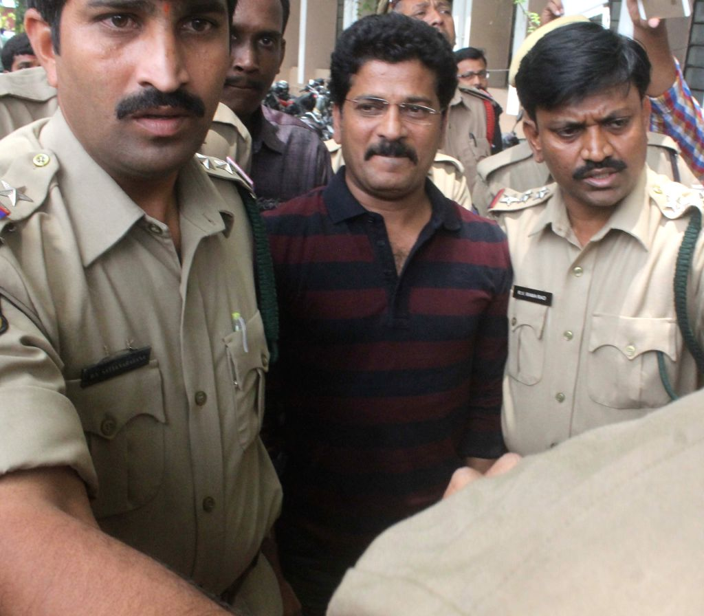 TDP MLA Revanth Reddy being taken to be produced before court in connection with cash-for-vote scam in Hyderabad on June 29, 2015. A special ACB court extended the judicial remand of the ...