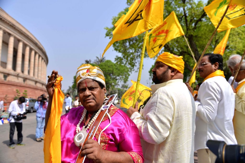 TDP MP Naramalli Sivaprasad stages demonstration to press for special economic status for Andhra Pradesh, ‎at Parliament in New Delhi on April 3, 2018.