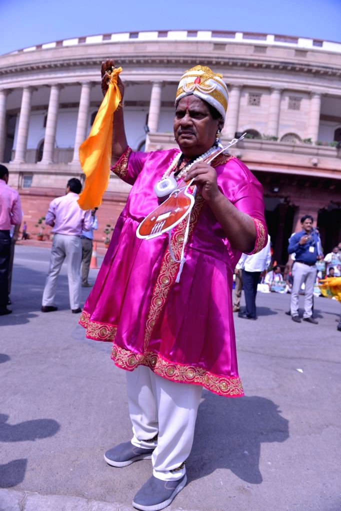TDP MP Naramalli Sivaprasad stages demonstration to press for special economic status for Andhra Pradesh, at Parliament in New Delhi on April 3, 2018.