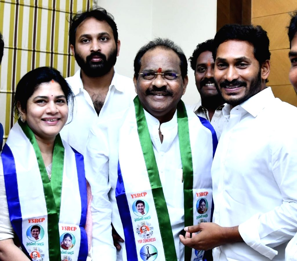 TDP MP Thota Narasimham and his wife Vani join YSR Congress Party in the presence of party president Y. S. Jaganmohan Reddy in Hyderabad on March 13, 2019.