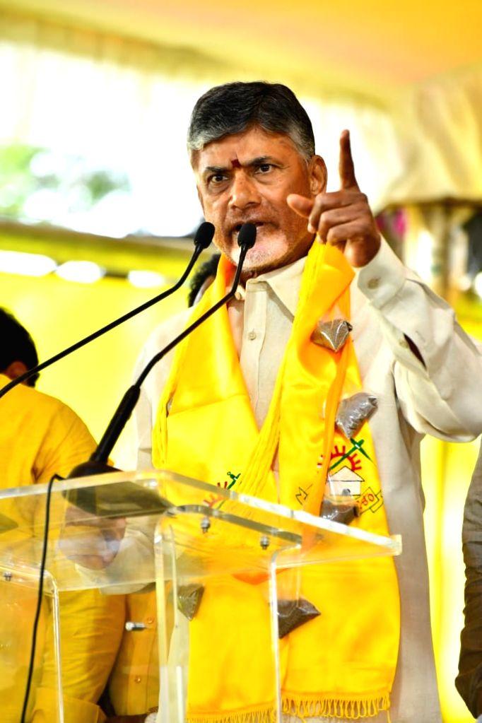 TDP President N. Chandrababu Naidu addresses party workers during a 12-hour-long fast undertaken by him over sand scarcity in Andhra Pradesh; in Vijayawada on Nov 14, 2019. Former Andhra ... - N. Chandrababu Naidu