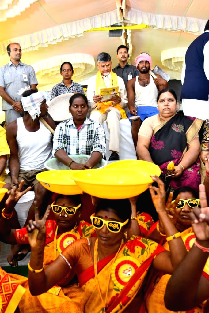 TDP President N. Chandrababu Naidu with party workers during a 12-hour-long fast undertaken by him over sand scarcity in Andhra Pradesh; in Vijayawada on Nov 14, 2019. Former Andhra ... - N. Chandrababu Naidu