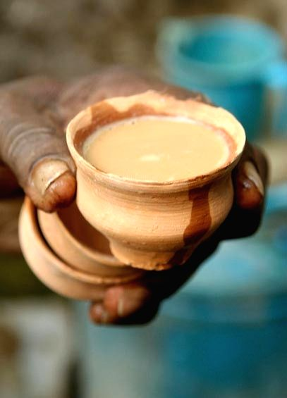 Tea being served in an earthen cup.