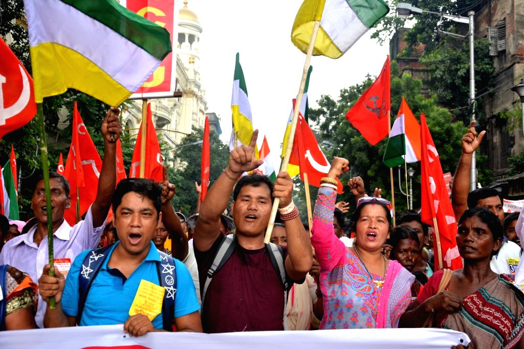Tea Garden Worker's Union activists stage a demonstration to press for their various demands in Kolkata on Aug 3. 2017.