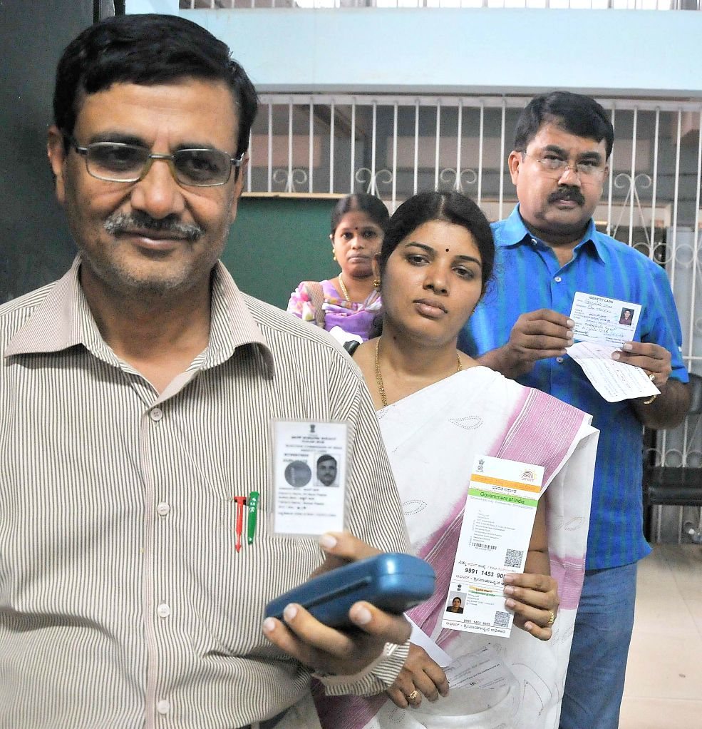 Teachers arrive to cast their votes during Teachers Constituency Election at Freedom Park in Bangalore on June 20, 2014.