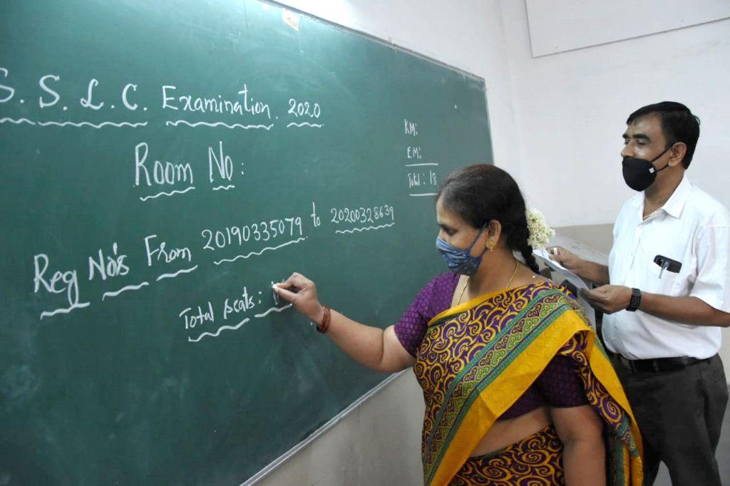 Teachers at Seshadripuram School write exam details on a blackboard ahead of conducting the remaining Secondary School Leaving Certificate (SSLC) exams, amid Unlock 1.0 or phased ...