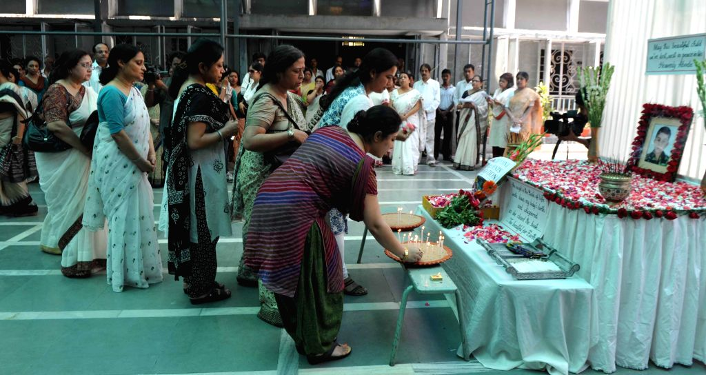 Teachers of South Point School pay tribute to 6-year-old Rajannya Sarkar who died in the school premises due to serious illness, in Kolkata on May 13, 2014.