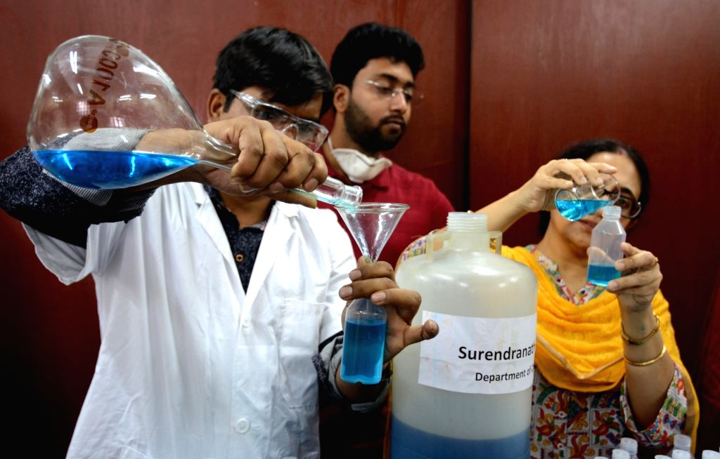 Teachers of Surendranath College, Chemistry department are making hand sanitizer to prevent  of COVID 19 or Coronavirus in Kolkata on March 19,2020.