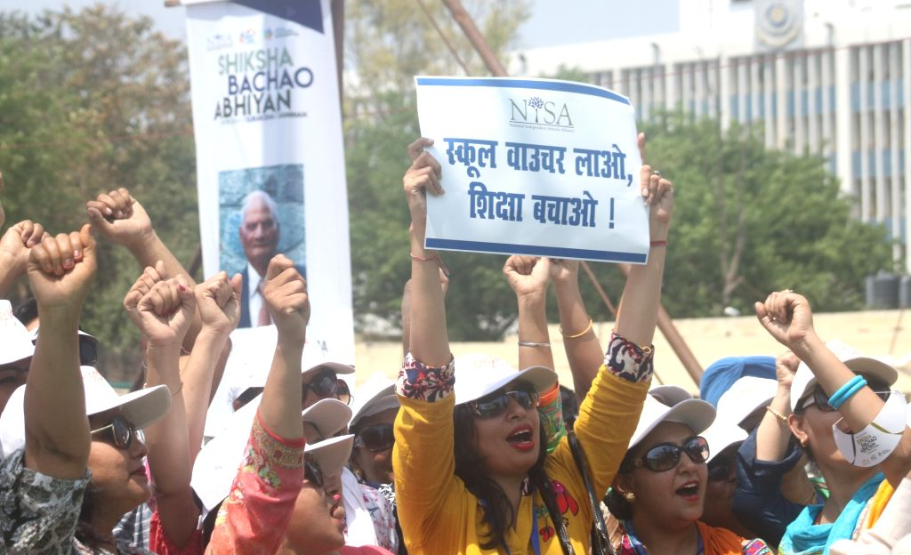 Teachers participate in  Shiksha Bachao Abhiyan rally organised by National Independent School's Association (NISA), in New Delhi on April 7, 2018.