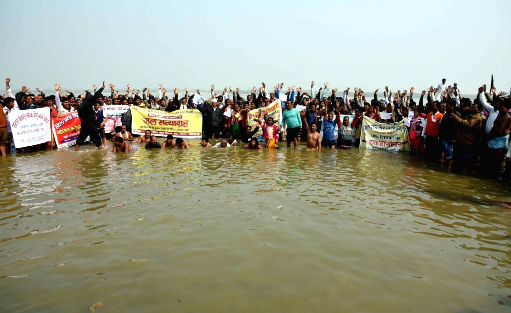 "Teachers stage a ""Jal Satyagraha"" in Ganga river to press for their demands in Patna on Feb 6, 2019."