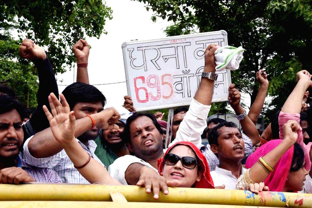 Teachers under the banner of Bihar Computer Teachers Welfare Association, stage a demonstration to press for their various demands, in Patna on July 17, 2019.