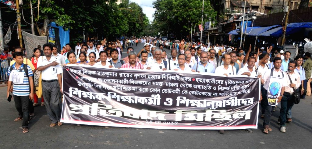 Teaching and non-teaching staff participate in a protest rally against death of a polling personnel during recently concluded West Bengal Panchayat Polls in Kolkata, on May 24, 2018.