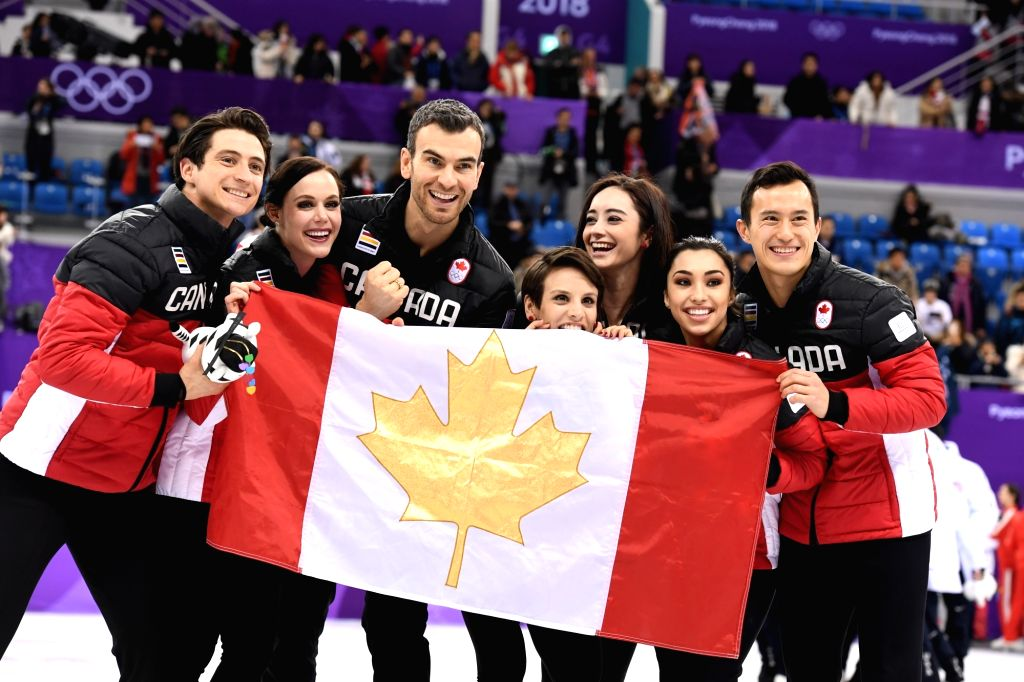 :Team Canada celebrate after winning the figure skating team event at the 2018 PyeongChang Winter Olympic Games, in Gangneung Ice Arena, South Korea, on Feb. ...